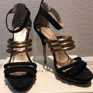 BCBG black and gold stiletto sandals.
